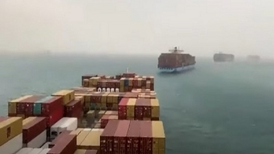 Navigation in the Suez Canal returns after it was stopped due to the stranding of a huge ship