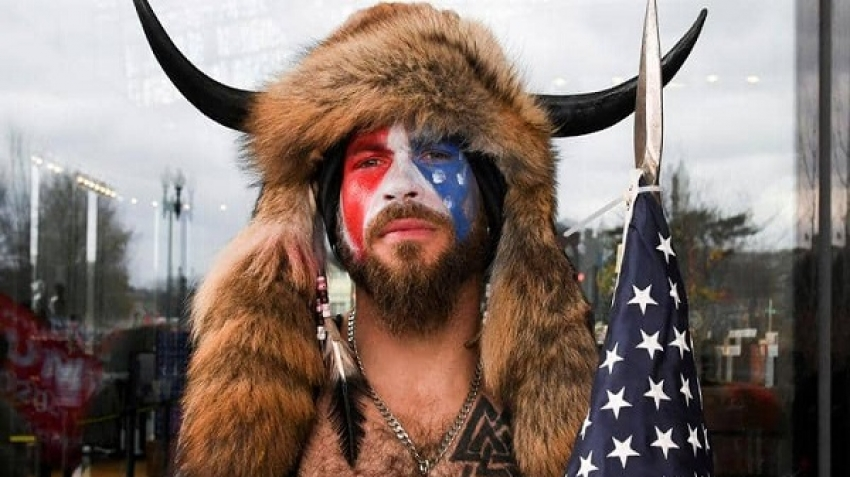 Arizona resident Jacob Chansley and a conspiracy theorist who has been widely reported pictured with fur on top of two horns.